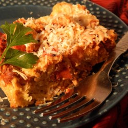 Meatball Bread Pudding Recipe - The ingredients in this dish are similar to the ones my mom uses to make meatballs--tomatoes, ground beef, cheese, and herbs bound together with eggs.  A great way to use dried-out leftover bread.