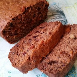 Persimmon Bread I Recipe - Reminiscent of apricots and honey, persimmons make a lovely bread when gently spiced with cinnamon, and augmented with raisins and chopped walnuts.