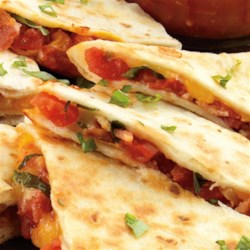 Bacon and Tomato Quesadillas Recipe - It's like a Mexican version of a BLT!  You choose whether you want it smoky or zesty by the flavor of petite diced tomatoes you use.  Crispy bacon and fresh basil add a new variation to the classic quesadilla.  A perfect party finger food or quick snack.