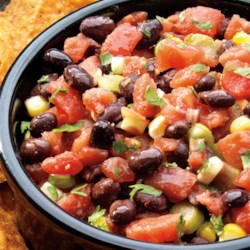 Black Bean and Corn Salsa from RED GOLD(R) Recipe - Fresh summer flavors any time of the year! Our tomatoes combined with corn and black beans, green onions and cilantro make the best dip. All you need is a sturdy chip!