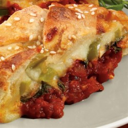 Pizza Stromboli Recipe - Handheld pizza for busy families on the go! Yummy pizza ingredients all wrapped in pre-made pizza or crescent dough. You decide what 'toppings' to add; veggies, sausage, pepperoni – whatever you like! If you don't like extra spice, feel free to leave out the red pepper for a milder sauce.