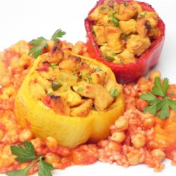 Mexican Chicken Stuffed Peppers Recipe - Chicken-stuffed peppers are baked in a tomato-based sauce and topped with rice and cheese for a different twist on the traditional stuffed pepper recipe.