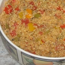 Mediterranean Quinoa Recipe - Onions and peppers are sauteed, then simmered with quinoa and tomatoes to make a delicious whole grain side dish. This colorful quinoa dish is easy to cook, and my toddler loves it!
