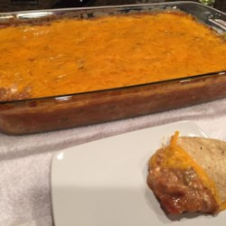 Mexican Lasagna Chip Dip Recipe - I'm not sure why it's called lasagna, but it is very good. A beef and refried bean mixture is buried in melted cheeses. Try serving it for a New Years or Super Bowl party.