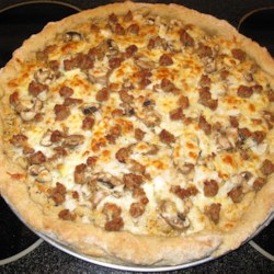 Rye Pizza Dough Recipe - Homemade pizza dough gets an interesting twist when rye flour is added to the dough for a nice change from the traditional crust.