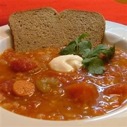 Tomato Barley Soup Recipe - Onions, celery, carrots and garlic are cooked with tomatoes in this chicken broth based soup with barley.