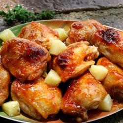Baked Apricot Chicken Recipe - Fruity and creamy, with a bite of onion for contrast--and made in a jiffy using salad dressing, onion soup mix, and apricot jam.