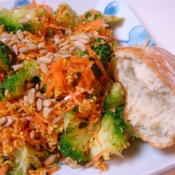 Broccoli Coleslaw Recipe - Broccoli, carrots, green onions and ramen noodles brought together with a dressing of olive oil, vinegar, sugar and chicken flavored seasoning.