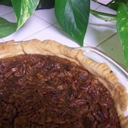 Pecan Pie VI Recipe - Nobody can resist a sweet and nutty pecan pie! This pecan pie is made with brown sugar and light corn syrup and is even more delicious when served with whipped cream.