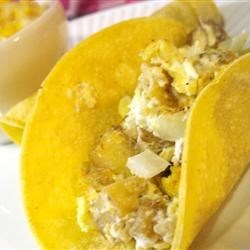 Breakfast Burritos with Green Salsa Recipe - Filled with chili seasoned potatoes, chorizo and scrambled eggs, these morning burritos are a fun and lightly spicy breakfast, designed to fill you up and get you excited for the day! Green salsa balances out the richness of the filling with its tangy, fresh flavor.