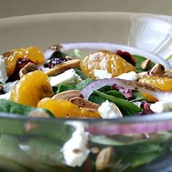 Beautiful Salad Recipe - A spur-of-the-moment creation when I wanted something with a great flavor punch and lots of color, plus quick to prepare---this one fills the bill, with  baby spinach and colorful cranberries and mandarin oranges, plus the crunch of sweetened  almonds and the pungent feta cheese---a new favorite at our house! You may substitute blue cheese for the feta and any kind of sweetened pecans or walnuts, if desired, for the almonds.