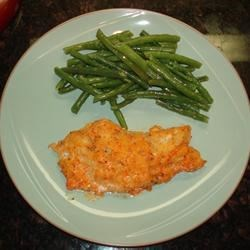 Baked Cod with Roasted Red Pepper Horseradish Sauce Recipe - A baked cod dish that's busting with flavor! Fillets are seasoned with garlic pepper, then bathed in a spicy red pepper and horseradish sauce, topped with a Cajun breading, and baked until golden brown.