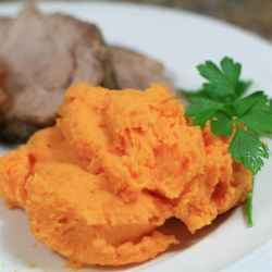 Creamy Mashed Sweet Potatoes Recipe - Just boil sweet potatoes, mash with Neufchatel cheese, and season with sea salt to make this simple and tasty side dish.