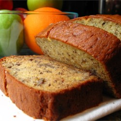Janet's Rich Banana Bread Recipe - Sour cream guarantees a moist and tender loaf.  And bananas are sliced instead of mashed in this recipe, giving a concentrated banana taste in every bite.