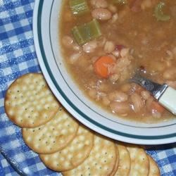 Bean Soup Recipe - This dried navy bean soup is made with a ham bone, cubed ham, carrots, onion, celery and bay leaves.