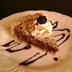 Tar Heel Pie Recipe - A very rich pie made with chocolate chips, coconut and pecans. Small slices are advised.
