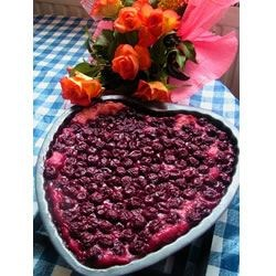 Cherry Dump Pudding Recipe - A vanilla-laced pudding is topped with sour cherries and sweetened cherry juices, and then it's baked for about 45 minutes.