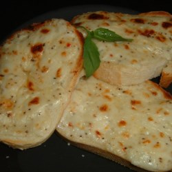 Creamy Cheese Bread Recipe - French bread topped with a creamy Swiss cheese spread tastes great as a party appetizer! These may be served without broiling.