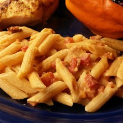 Penne Alla Vodka Recipe - Penne pasta is tossed in a bacon-infused vodka sauce creating a quick and easy dinner for weeknights or dinner parties.