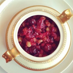 Cranberry, Apple, and Fresh Ginger Chutney Recipe - Fresh ginger puts the bite on tart cranberries and crisp apples cooked up with onion, celery, raisins, and just enough sugar to keep your lips from puckering.