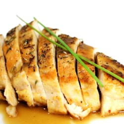 Million Dollar Chicken Recipe - A chicken stuffed with lemon and herbs is roasted in a hot oven on top of sliced sourdough bread and glazed with a creme fraiche sauce for a million-dollar flavor.