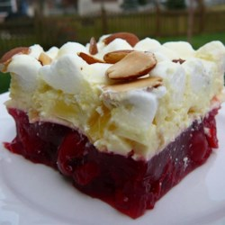 Freda's Cherry Supreme Salad Recipe - A creamy pineapple and marshmallow layer tops a strawberry-cherry base in this family recipe that's sure to be a hit at family gatherings.
