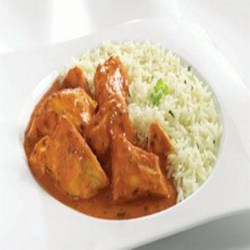 Lasooni Murgh (Garlic Flavored Spicy Chicken) Recipe - Chicken is marinated overnight in spiced yogurt, then cooked together with cumin and cream in this traditional Indian dish.  It is creamy and full of flavor and should be served over some kind of carb (rice, potatoes, naan) to absorb and dissimulate the spice.
