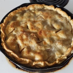 Grandma's Iron Skillet Apple Pie Recipe - A modern version of an old-time favorite uses premade pie crusts to make this three-layer apple pie, baked in a cast iron skillet.
