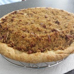 Apple Butter Pumpkin Pie Recipe - A delightful combination of two Autumn standards - apple and pumpkin - in this lightly spiced pie with a streusel topping.