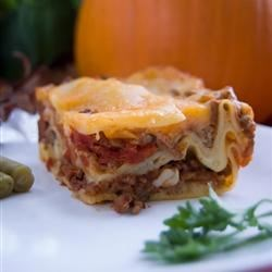 Restaurant Style Lasagna Recipe - Three types of cheese make this lasagna with meat sauce a cheesy, savory delight!