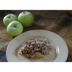 Microwave Apple Crisp Recipe - I don't usually like 'baking' with the microwave, but this recipe works great. The topping comes out crispy on top, moist inside, and delicious all around. It's a wonderful dessert that's quick and easy to make. Best served warm with vanilla ice cream or whipped topping.