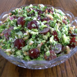 Red Broccoli Salad Recipe and Video - This recipe calls for lots and lots of crumbled, maple-flavored bacon, chopped  broccoli, red and green onion, red grapes and toasted almonds. Everything is then tossed with a sweet mayonnaise and vinegar dressing.