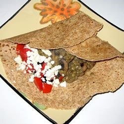 Easy Lentil Feta Wraps Recipe - Very tasty and very quick! My husband loves it, and I love that it takes only a few minutes to make! Use any or all of the ingredients, or whatever you have on hand! White wine may be substituted with heavy cream.