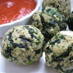 Spinach Balls Recipe - Spinach is combined with stuffing mix, Parmesan cheese, butter, eggs and savory spices. The mixture is formed into balls and baked.