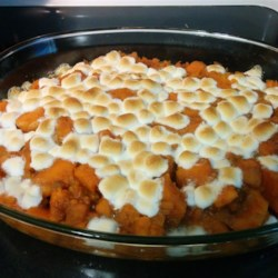 Candied Sweet Potatoes Recipe - Sweet potatoes are parboiled and then baked with a sweet sauce of margarine, brown sugar, marshmallows, cinnamon and nutmeg.