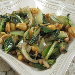 Stir Fried Bok Choy Recipe - Bok choy is stir-fried with cashews, Chinese five-spice, and garlic for a quick and easy Asian-inspired side dish.