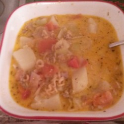 Spicy Veggie Cabbage Soup Recipe - Coleslaw mix puts the cabbage into this soup recipe with spicy Italian sausage and an assortment of hearty vegetables to deliver a comforting bowl of warm soup.