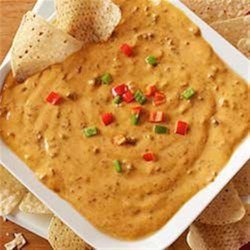 Chili Cheese Dip from Hormel(R) Chili Recipe - Whether you need a tailgating triumph or a satisfying weeknight snack, this delicious dip is guaranteed to be a hit with your crowd.