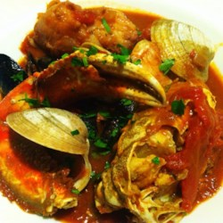 Fisherman's Wharf Cioppino Recipe - This seafood stew from San Francisco simmers cod, shrimp, clams, and mussels in a white wine and chicken broth base.