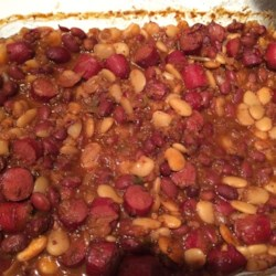 Three Bean Casserole Recipe - Sliced hotdogs are baked with chili beans, butter beans, and pork and beans, along with onion, a little brown sugar, oregano, and vinegar in this quick and easy one-pot meal.