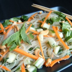 Vietnamese Rice-Noodle Salad Recipe - Cooked rice noodles are mixed with carrots, cucumbers, mint, and Napa cabbage. A sauce made with cilantro, jalapeno peppers, lime juice, fish sauce, and sugar is spooned over the noodles and veggies.