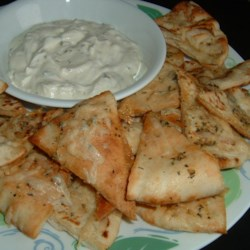 Garlic Pita Bread Bites Recipe - Pita bread pieces slathered with a buttery garlic mixture are great with Italian food or by themselves as a snack.