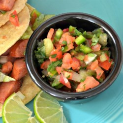 Caliente Christmas Salsa Recipe - This colorful salsa is delicious and spicy salsa and, when bottled, makes a nice gift!
