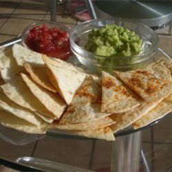 Baked Tortilla Chips Recipe - Cumin and lime juice add a real zing to these chips, and they're best when served warm.