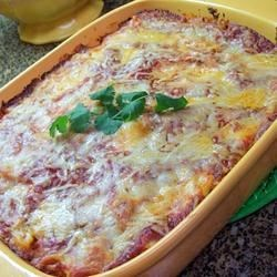Baked Ziti II Recipe and Video - Rich and creamy ricotta cheese is combined with mozzarella, beaten egg and spaghetti sauce to make a rich and filling sauce for cooked ziti. Top with Parmesan cheese and bake for a delicious, classic Italian casserole.