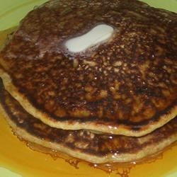 Dairy Free Whole Wheat Pancakes Recipe - These healthy pancakes with a hint of almond are delicious.  They're thick and fluffy and they really stick to your ribs. Serve warm with maple syrup or peach jam. Leftovers are great served cold with a little peach jam spread on them, yum!