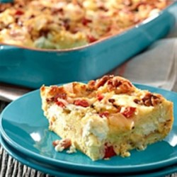 Hearty Egg and Bread Bake Recipe - This hearty casserole is great for brunch or a main meal. Serve with a fruit or green salad for a simple yet delicious meal.