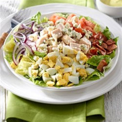 Mini Cobb Salad with Avocado Dressing Recipe - Whether you're counting calories or not, using turkey-style bacon and less blue cheese is a simple way to reduce the calories and fat in this classic main course salad. Topped off with a refreshing avocado dressing, this salad is sure to please!