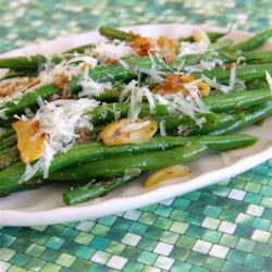 Garlicky Green Beans with Shallot Recipe - This recipe seasons green beans with shallot and garlic and then adds Parmesan cheese for a great side dish suitable for Thanksgiving dinner.