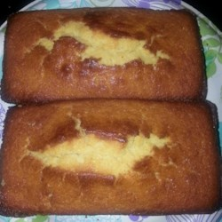 Sweet Corn Bread Recipe - Cornbread with a little added sweetness is a nice accompaniment to any meal. Try making them into muffins for a tasty breakfast treat.
